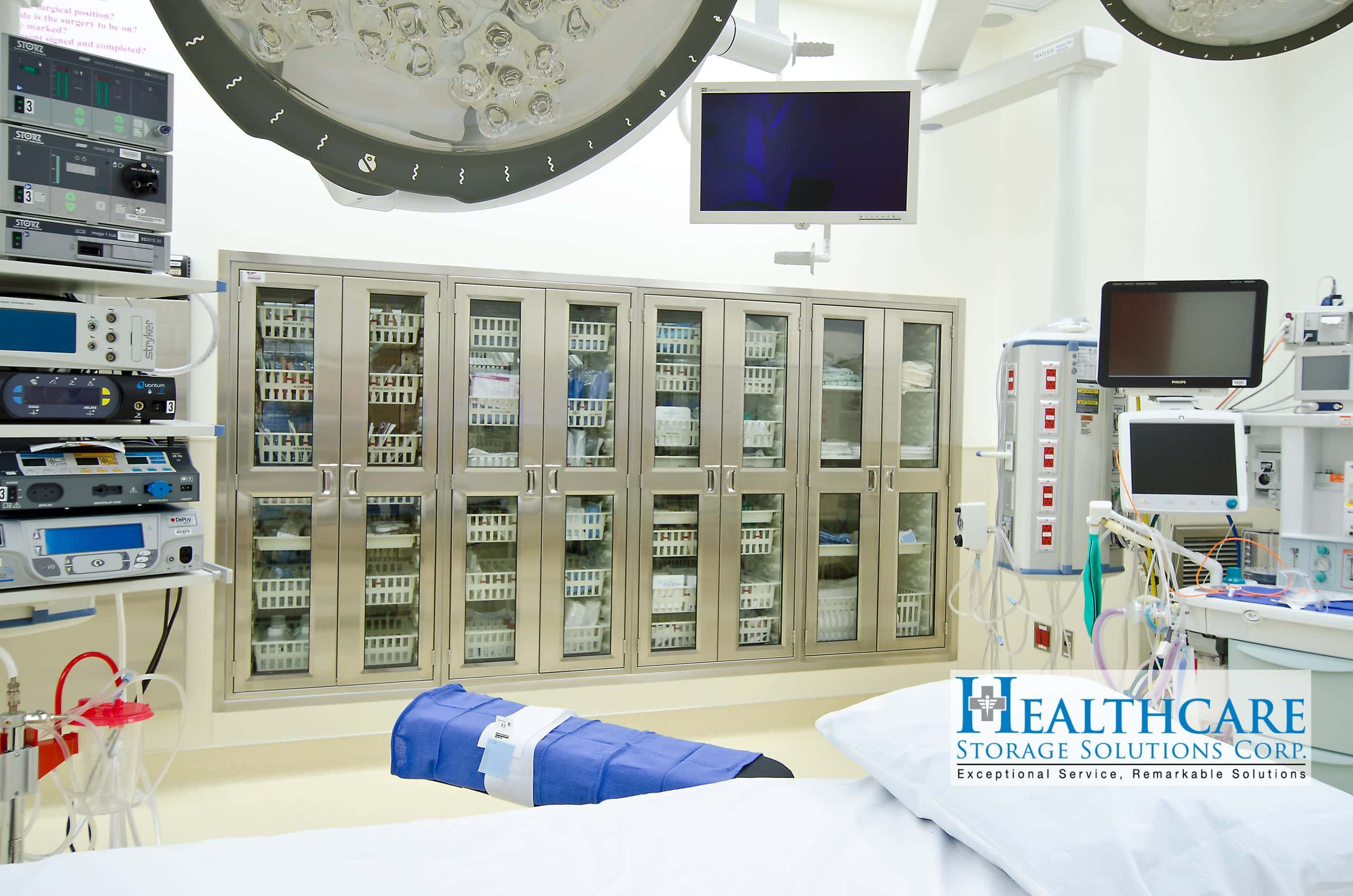 Image shows an operating room suite with high-density stainless steel cabinets.